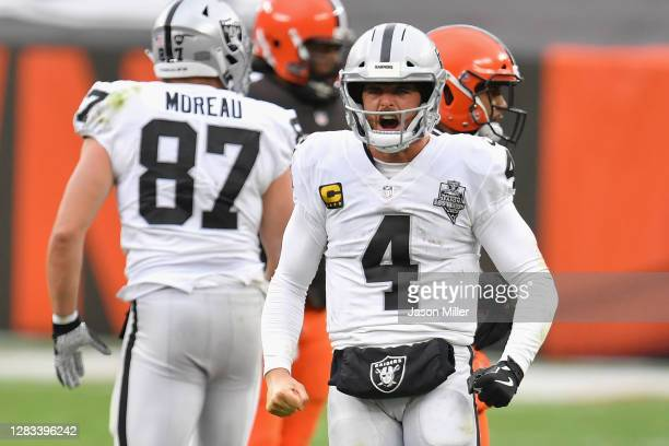 Quarterback Derek Carr of the Las Vegas Raiders celebrates a first down rush against the Cleveland Browns during the second half of the NFL game at...