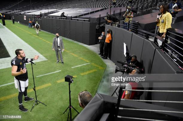 Quarterback Derek Carr of the Las Vegas Raiders is interviewed by reporter Lisa Salters after the Raiders defeated the New Orleans Saints 3424 in the...