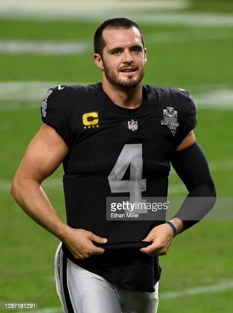Quarterback Derek Carr of the Las Vegas Raiders walks off the field after a 35-31 loss to the Kansas City Chiefs at Allegiant Stadium on November 22,...