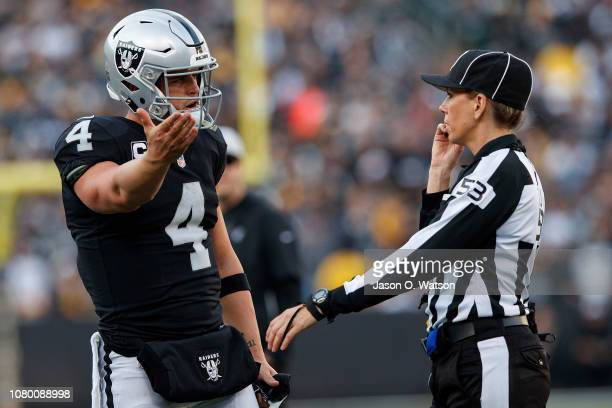 Quarterback Derek Carr of the Oakland Raiders argues a call with line judge Sarah Thomas during the third quarter against the Pittsburgh Steelers at...