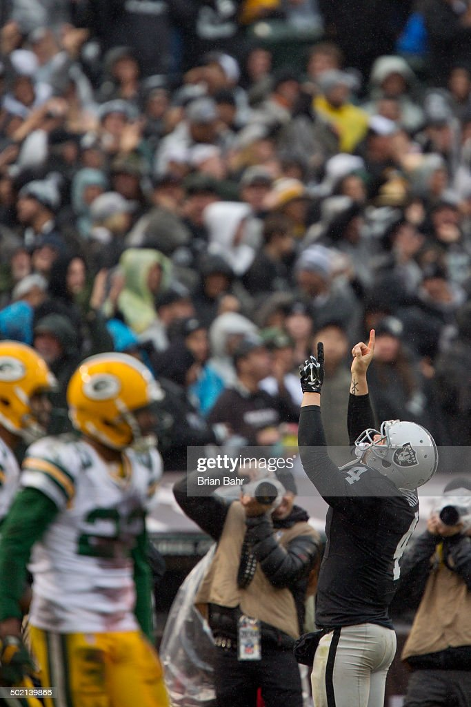 Quarterback Derek Carr #4 of the Oakland Raiders celebrates a touchdown against the Green Bay Packers on December 20, 2015 at O.co Coliseum in Oakland, California. The Packers won 30-20.