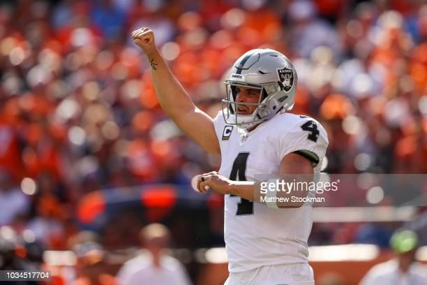 Quarterback Derek Carr of the Oakland Raiders celebrates after a second quarter touchdown against the Denver Broncos at Broncos Stadium at Mile High...