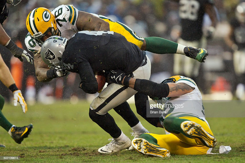 Quarterback Derek Carr #4 of the Oakland Raiders gets sacked by defensive tackle Mike Daniels #76 of the Green Bay Packers in the second half on December 20, 2015 at O.co Coliseum in Oakland, California. The Packers won 30-20.