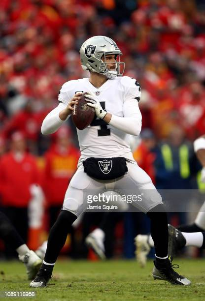 Quarterback Derek Carr of the Oakland Raiders in action during the game against the Kansas City Chiefs at Arrowhead Stadium on December 30 2018 in...