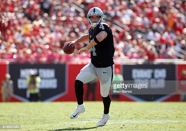Quarterback Derek Carr of the Oakland Raiders looks for an open receiver during the fourth quarter of an NFL game against the Tampa Bay Buccaneers on...