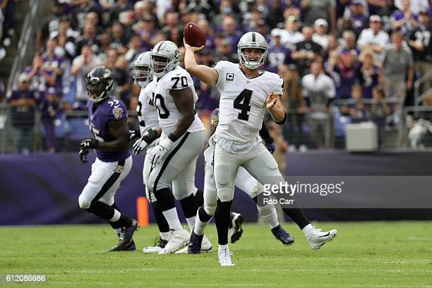 Quarterback Derek Carr of the Oakland Raiders looks to pass against the Baltimore Ravens at MT Bank Stadium on October 2 2016 in Baltimore Maryland