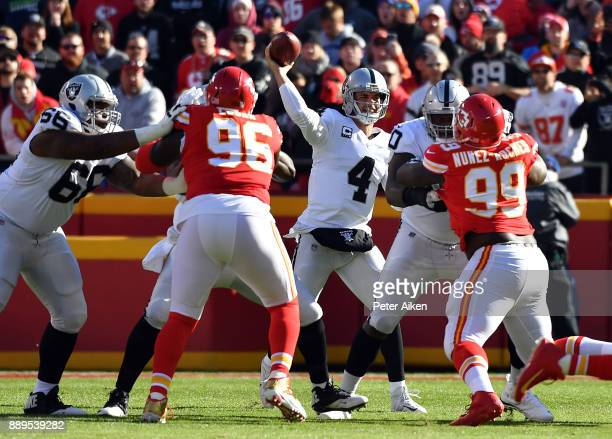 Quarterback Derek Carr of the Oakland Raiders passes during the game against the Kansas City Chiefs at Arrowhead Stadium on December 10 2017 in...