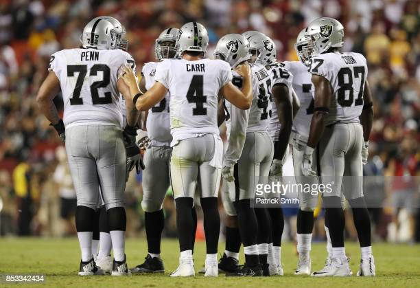 Quarterback Derek Carr of the Oakland Raiders talks to his team in the fourth quarter of play against the Washington Redskins at FedExField on...