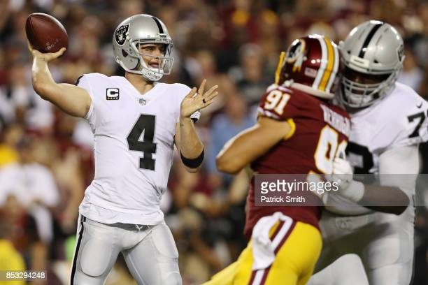 Quarterback Derek Carr of the Oakland Raiders throws in the first quarter of play against the Washington Redskins at FedExField on September 24 2017...