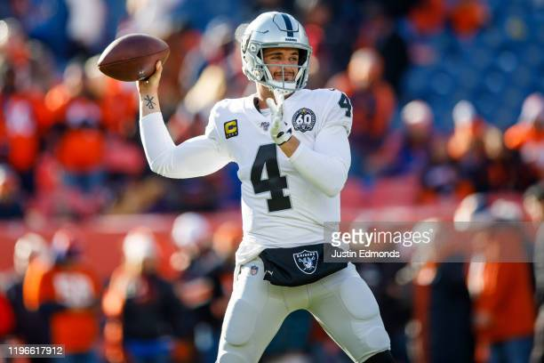 Quarterback Derek Carr of the Oakland Raiders warms up before the game against the Denver Broncos at Empower Field at Mile High on December 29, 2019...