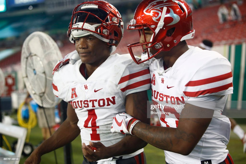 Quarterback D'Eriq King #4 of the Houston Cougars celebrates with wide receiver Kinte Hatton #33 following the Cougars' 28-24 win over the South Florida Bulls at an NCAA football game on October 28, 2017 at Raymond James Stadium in Tampa, Florida.