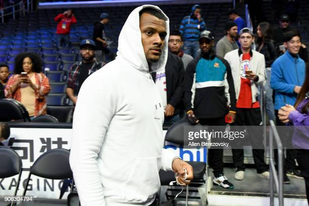 Quarterback Deshaun Watson attends a basketball game between the Los Angeles Clippers and the Denver Nuggets at Staples Center on January 17 2018 in...