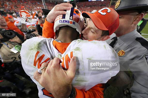 Quarterback Deshaun Watson hugs head coach Dabo Swinney of the Clemson Tigers after defeating the Alabama Crimson Tide 3531 to win the 2017 College...