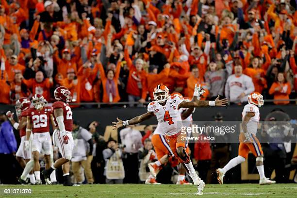 Quarterback Deshaun Watson of the Clemson Tigers celebrates after throwing a 2-yard game-winning touchdown pass during the fourth quarter against the...