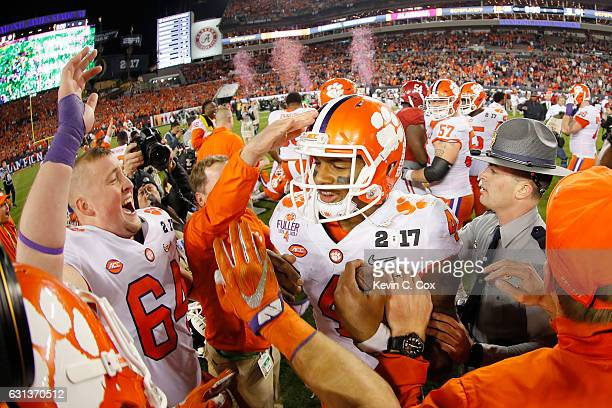 Quarterback Deshaun Watson of the Clemson Tigers celebrates with teammates after defeating the Alabama Crimson Tide 3531 to win the 2017 College...