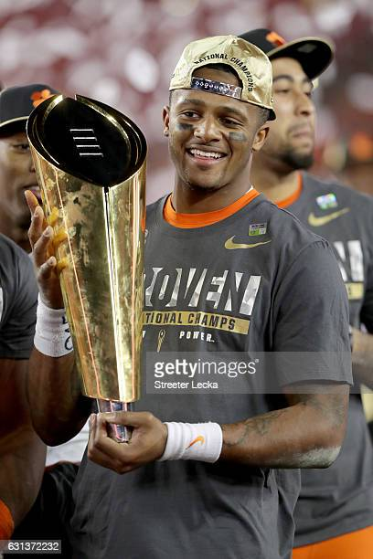 Quarterback Deshaun Watson of the Clemson Tigers celebrates with the College Football Playoff National Championship Trophy after defeating the...