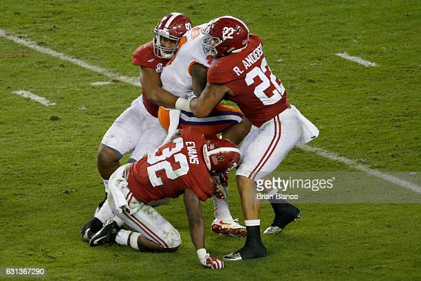 Quarterback Deshaun Watson of the Clemson Tigers is tackled by defensive lineman Jonathan Allen linebacker Ryan Anderson and linebacker Rashaan Evans...