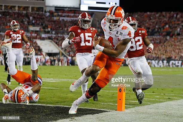 Quarterback Deshaun Watson of the Clemson Tigers rushes for an 8yard touchdown during the second quarter against the Alabama Crimson Tide in the 2017...