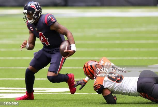 Quarterback Deshaun Watson of the Houston Texans avoids the tackle by defensive end Amani Bledsoe of the Cincinnati Bengals during the first quarter...
