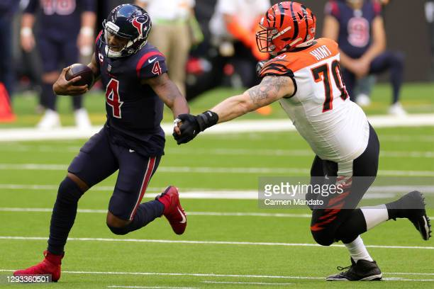 Quarterback Deshaun Watson of the Houston Texans avoids the tackle by defensive end Margus Hunt of the Cincinnati Bengals during the fourth quarter...