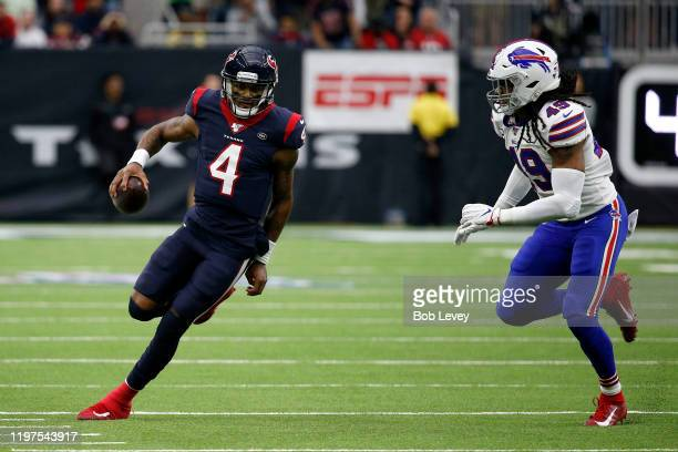 Quarterback Deshaun Watson of the Houston Texans carries the ball against Tremaine Edmunds of the Buffalo Bills during the AFC Wild Card Playoff game...