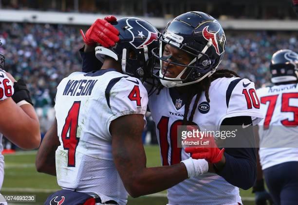 Quarterback Deshaun Watson of the Houston Texans celebrates his touchdown with teammate wide receiver DeAndre Hopkins against the Philadelphia Eagles...