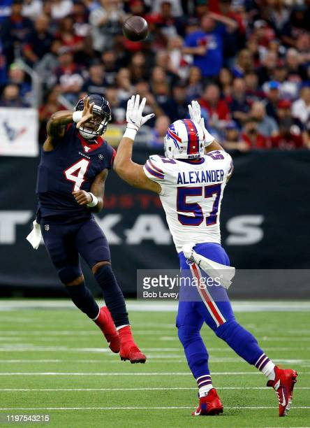Quarterback Deshaun Watson of the Houston Texans delivers a pass over Lorenzo Alexander of the Buffalo Bills during the AFC Wild Card Playoff game at...