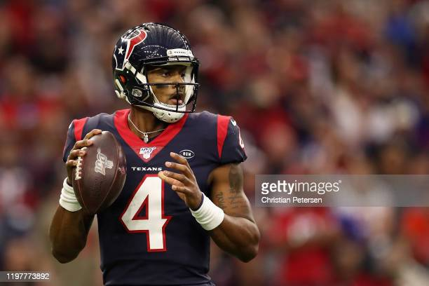 Quarterback Deshaun Watson of the Houston Texans drops back to pass during the NFL Wild Card playoff game against the Buffalo Bills at NRG Stadium on...