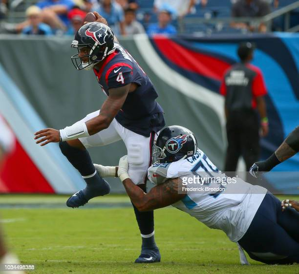 Quarterback Deshaun Watson of the Houston Texans is tackled by Jurrell Casey of the Tennessee Titans during the first half at Nissan Stadium on...