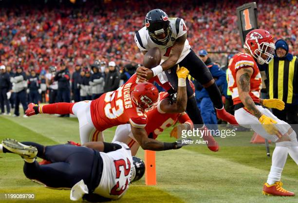 Quarterback Deshaun Watson of the Houston Texans leaps for a touchdown over Anthony Hitchens of the Kansas City Chiefs in the fourth quarter of the...
