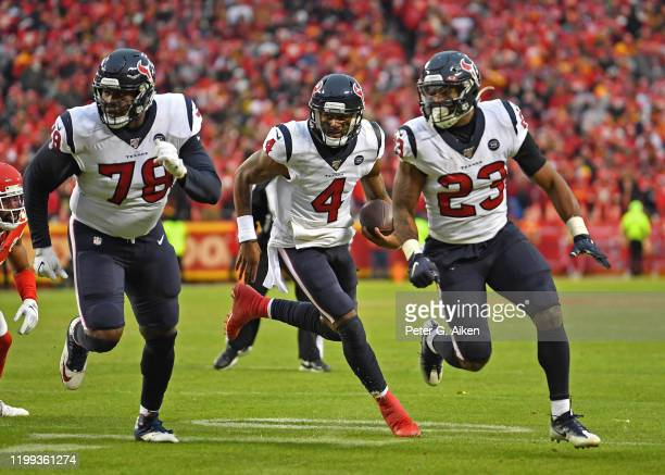 Quarterback Deshaun Watson of the Houston Texans rolls out with offensive tackle Laremy Tunsil and running back Carlos Hyde in the second half of...