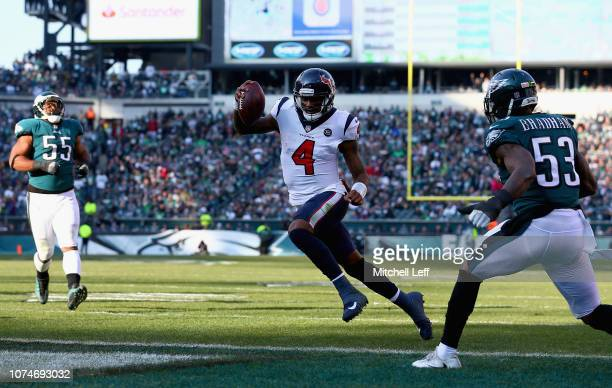 Quarterback Deshaun Watson of the Houston Texans runs for a touchdown against the Philadelphia Eagles during the second quarter at Lincoln Financial...