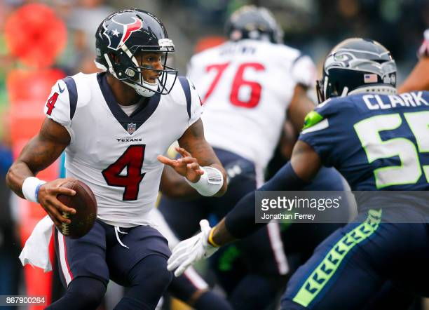 Quarterback Deshaun Watson of the Houston Texans rushes against Frank Clark of the Seattle Seahawks at CenturyLink Field on October 29 2017 in...