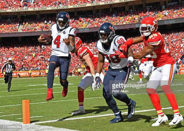 Quarterback Deshaun Watson of the Houston Texans rushes into the end zone for a touchdown against the Kansas City Chiefs during the second quarter at...