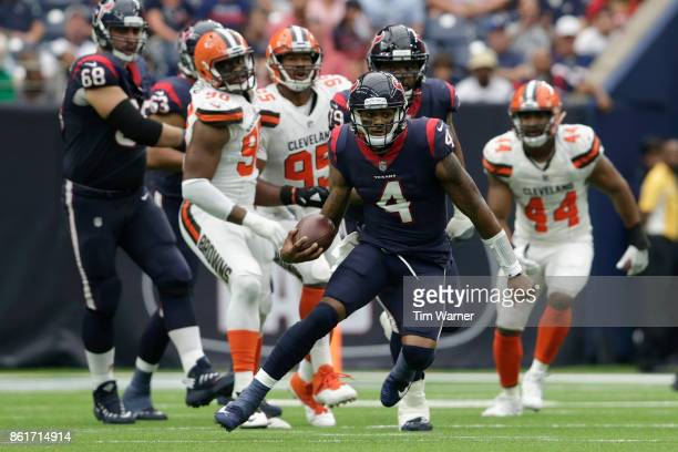 Quarterback Deshaun Watson of the Houston Texans scrambles in the fourth quarter against the Cleveland Browns at NRG Stadium on October 15, 2017 in...