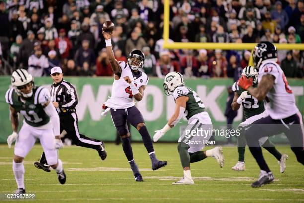 Quarterback Deshaun Watson of the Houston Texans throws a firstdown pass against the New York Jets during the fourth quarter at MetLife Stadium on...