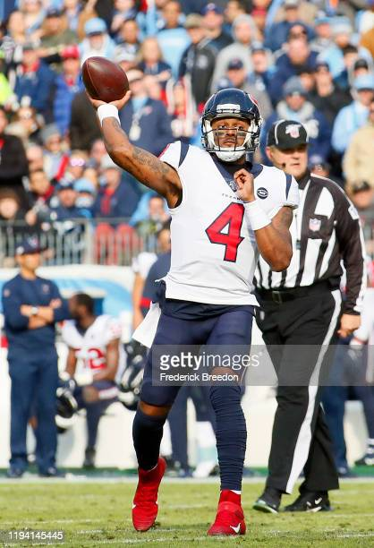 Quarterback Deshaun Watson of the Houston Texans throws a touchdown pass against the Tennessee Titans during the first half at Nissan Stadium on...