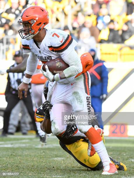 Quarterback DeShone Kizer of the Cleveland Browns breaks the tackle of linebacker Bud Dupree of the Pittsburgh Steelers as he carries the ball...