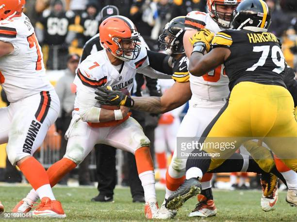 Quarterback DeShone Kizer of the Cleveland Browns breaks to tackle of defensive tackle Tyson Alualu of the Pittsburgh Steelers in the fourth quarter...