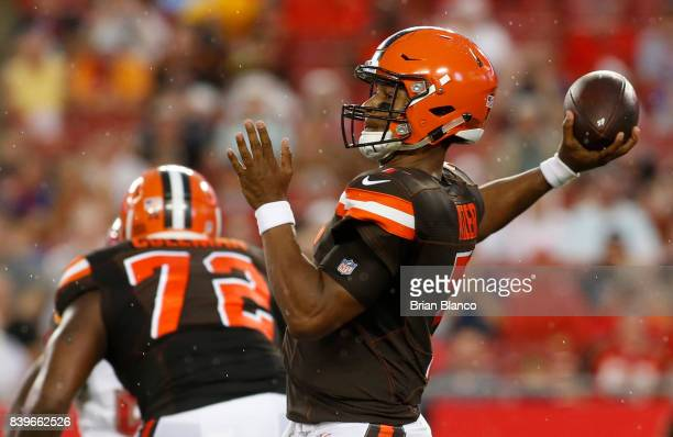 Quarterback DeShone Kizer of the Cleveland Browns drops back to pass to an open receiver during the first quarter of an NFL preseason football game...