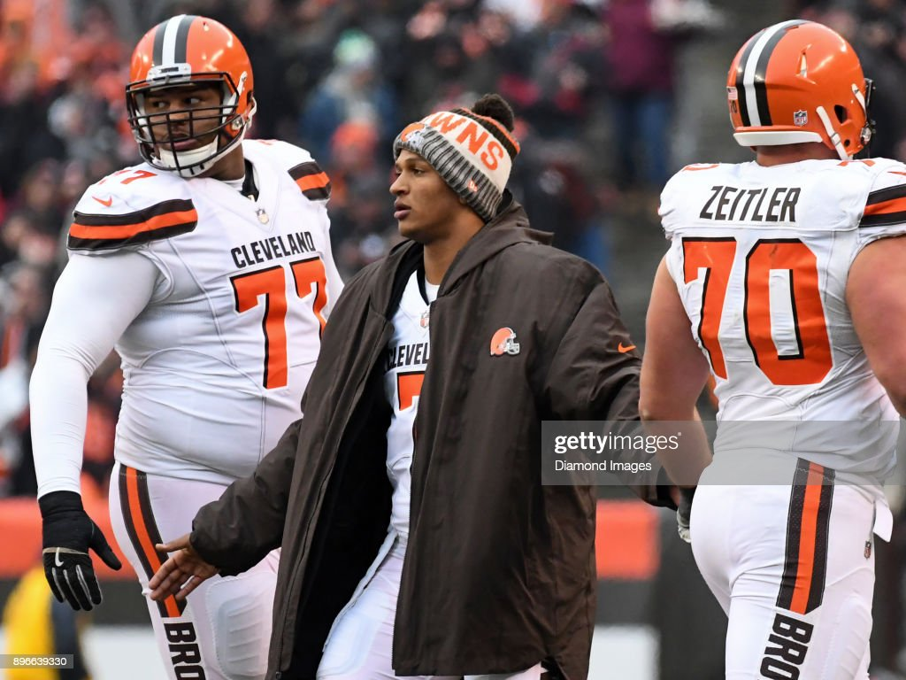 Quarterback DeShone Kizer #7 of the Cleveland Browns greets tackle Zach Banner #77 and right guard Kevin Zeitler #70 after an extra point attempt in the second quarter of a game on December 17, 2017 against the Baltimore Ravens at FirstEnergy Stadium in Cleveland, Ohio. Baltimore won 27-10.