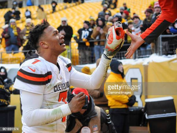Quarterback DeShone Kizer of the Cleveland Browns hands one of his cleats to a fan after a game on December 31 2017 against the Pittsburgh Steelers...