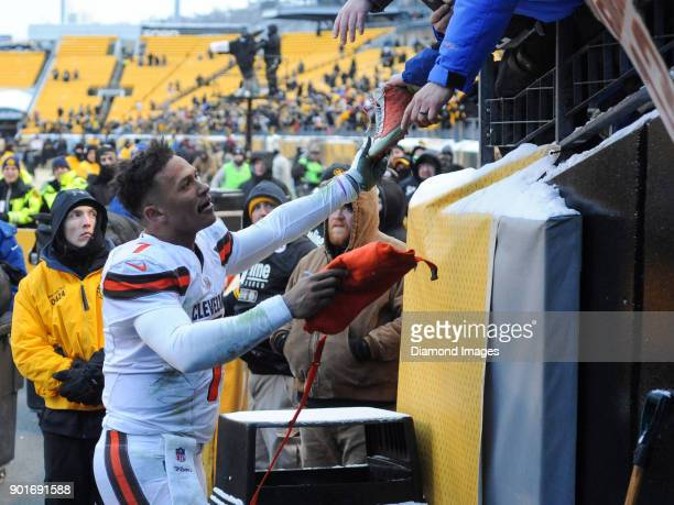 Quarterback DeShone Kizer of the Cleveland Browns hands parts of his equipment to fans after a game on December 31 2017 against the Pittsburgh...