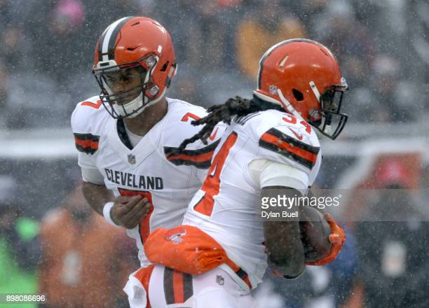 Quarterback DeShone Kizer of the Cleveland Browns hands the football off to Isaiah Crowell in the first quarter against the Chicago Bears at Soldier...