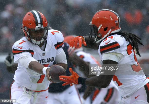 Quarterback DeShone Kizer of the Cleveland Browns hands the football off to Isaiah Crowell in the second quarter at Soldier Field on December 24 2017...