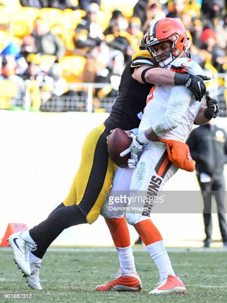 Quarterback DeShone Kizer of the Cleveland Browns is sacked by linebacker LJ Fort of the Pittsburgh Steelers in the third quarter of a game on...
