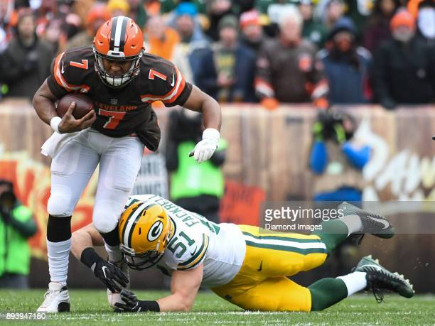 Quarterback DeShone Kizer of the Cleveland Browns is tackled by linebacker Kyler Fackrell of the Green Bay Packers in the first quarter of a game on...