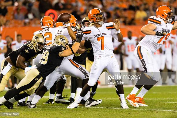 Quarterback DeShone Kizer of the Cleveland Browns passes while under pressure from linebacker Adam Bighill of the New Orleans Saints during the...