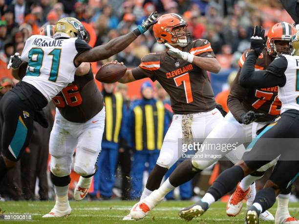Quarterback DeShone Kizer of the Cleveland Browns throws a pass as defensive end Yannick Ngakoue of the Jacksonville Jaguars attempts to knock the...