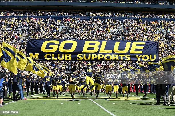 Quarterback Devin Gardner of the Michigan Wolverines leads the team onto the field prior to the start of the game against the Miami University...